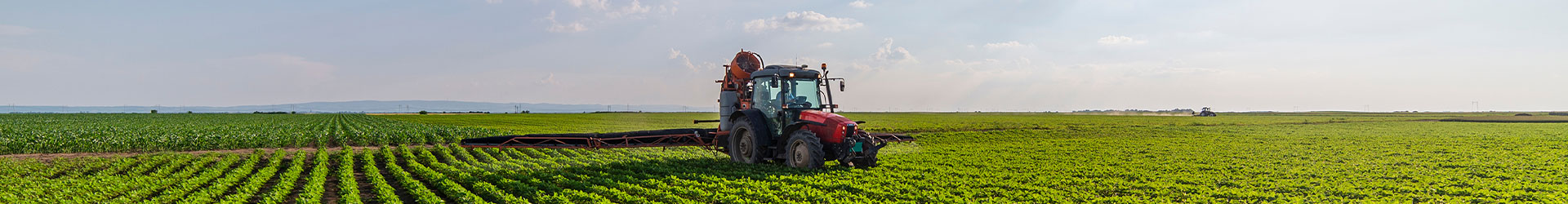 A banner image showing a tractor in a field of crops