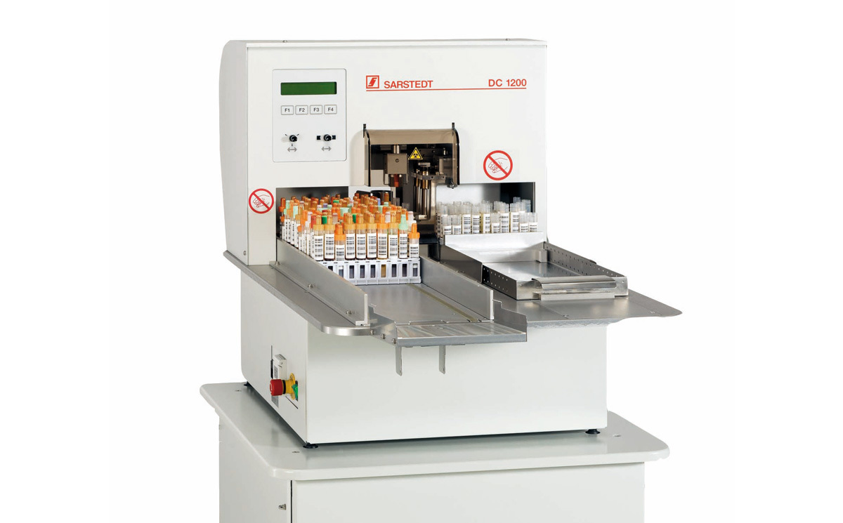 Image of SafeCollect samples being processed by a machine