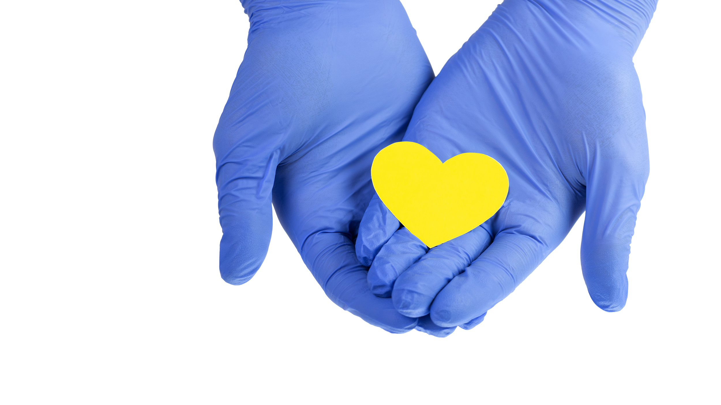 Rubber gloves holding yellow heart
